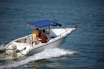 Sport Fishing Boat with Blue Canvas Canopy