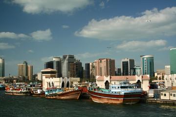 Dubai skyline with river, blue sky and white clouds