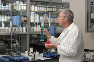 Senior chemist formulating in a laboratory