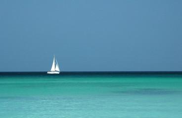 sailboat on a tropical sea