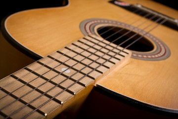 Close-up of classic acoustic guitar. Shallow DOF..
