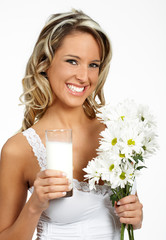 Young happy woman  drinking milk. Over white background  .