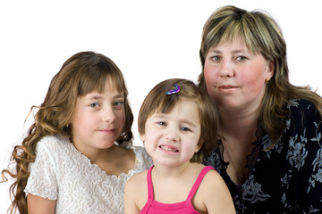 Mother with two daughters posing together isolated on white