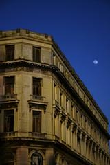 Havana building facade at dusk with early moon
