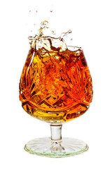 Wall Mural - snifter glass full to the brim with brandy and splash