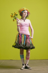Pretty young woman with punk clothes with plastic flowers.