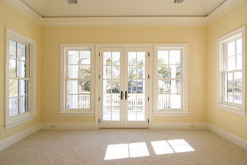 bedroom with windows and doors looking onto porch with view