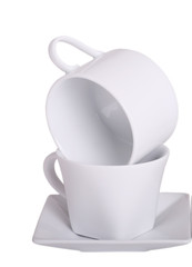 Stack of two coffee cups with saucer on white background