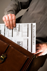 Businessman holding business report