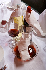 The served table with red and white wine at restaurant.