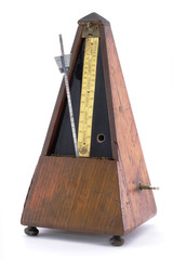 Classic old  metronome isolated on white background