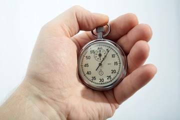 An image of a stopwatch in a hand