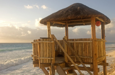 A bamboo and straw lifeguard hut on the beach