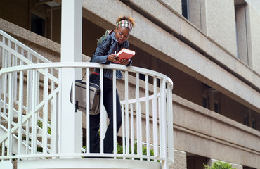 African American college student on campus staircase