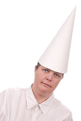 Woman in a dunce cap with eyes open over a white background