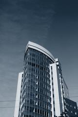 Fotobehang - Modern office building over blue sky.