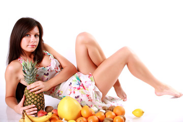 Girl with a lot of different fruits