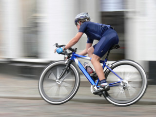A junior racing cycler in competition