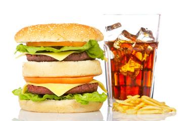 Hamburger and soda, reflected on white background. Shallow DOF