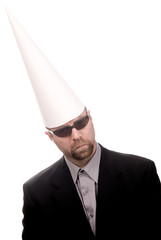 Man in a dunce cap and sunglasses