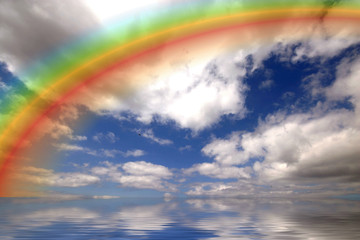 rainbow and clous reflected in the ocean