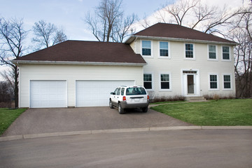 a white middle class home in suburbia