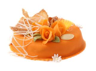 orange cake with orange rooses over white