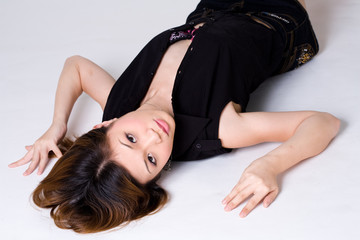 young sensual brunette woman lying on the floor