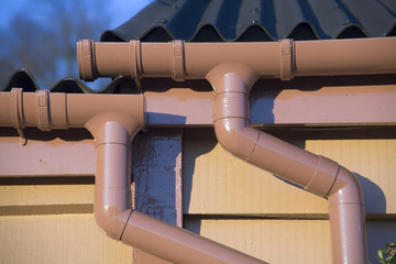 A drainpipe on the roof of a building.