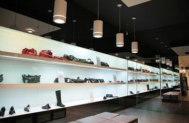 shelfs in store with bags and shoes