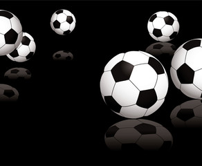 Collection of footballs on a black reflective background