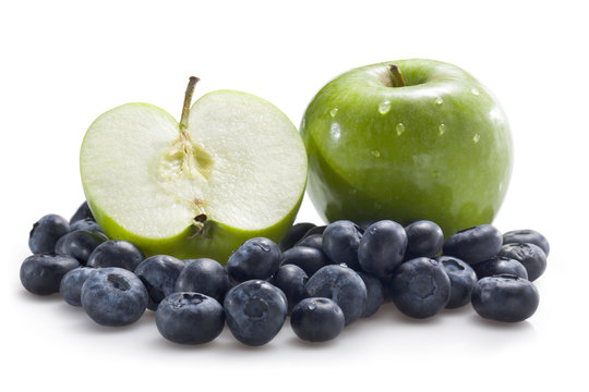Apples and blueberries isolated on white