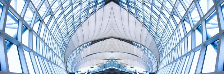 grey unusual geometric ceiling of office building, panorama