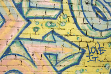 """Graffitti on brick wall with arrow pointing to """"love it"""""""