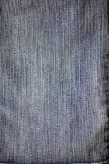 Details from old blue jeans trousers background