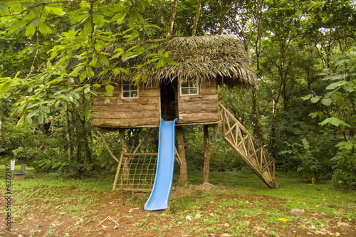 Small tree house with slide stock photo and royalty free for Small tree house