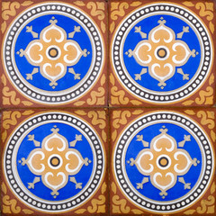 A panel of four Victorian Arts & Crafts floor tiles