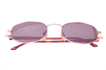 folded sunglasses isolated on white
