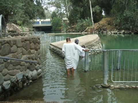 People baptizing in Jordan River in Israel