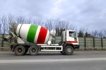 A cement lorry being driven along a motorway.