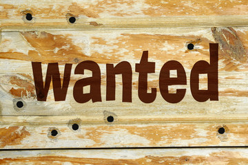 Bullet holes and Wanted sign into wood background