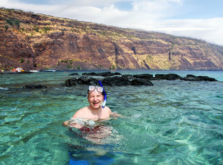 Happy mature man snorkeling on Big Island, Hawaii