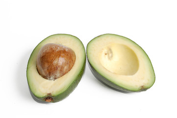 Sliced avocado over white background