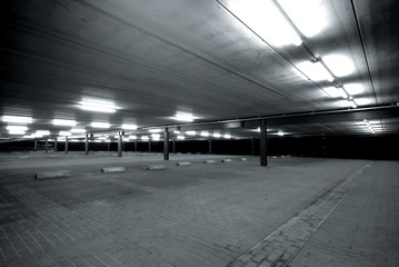 an empty spacious parking lot in black and white