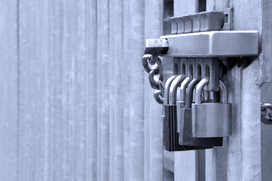 Five padlocks on a metal gate, concept shot for security
