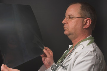 A radiologist looking at a patients x-ray.