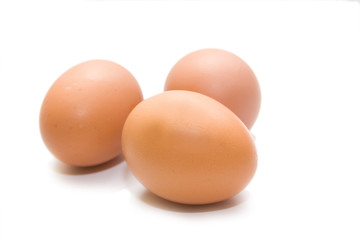 three eggs on the white isolated background