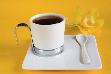 mug of tea and flower