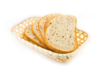 Fresh baked bread sliced in the basket
