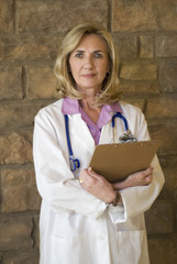 attractive female doctor holding charts